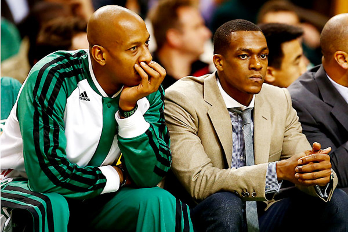 There may be no one happier to ride the bench for a losing team than the Celtics' Keith Bogans (left).