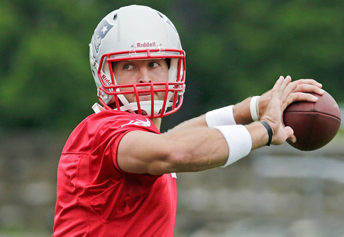Tim Tebow spent his second day at camp watching Tom Brady before taking a few snaps late in the day.