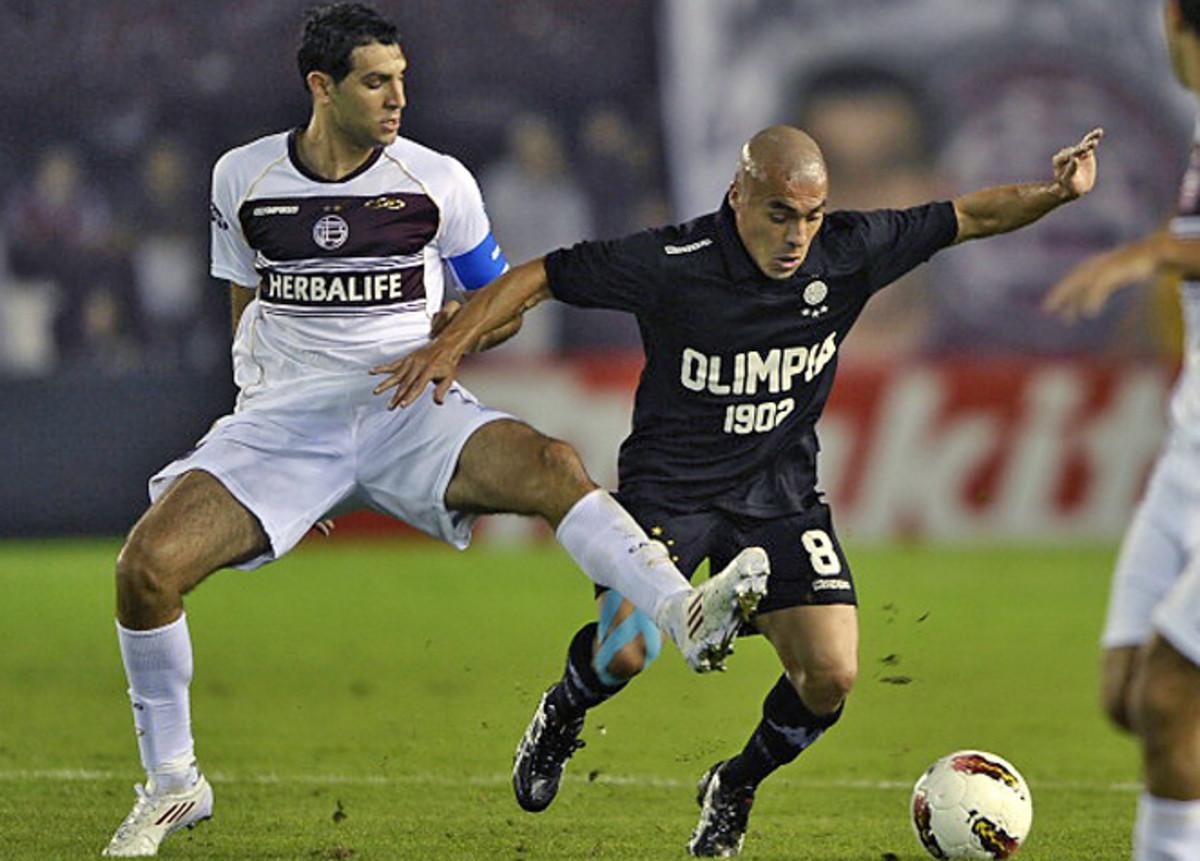 In nine seasons with Lanus, Diego Valeri (left) has registered 25 goals over 158 matches.