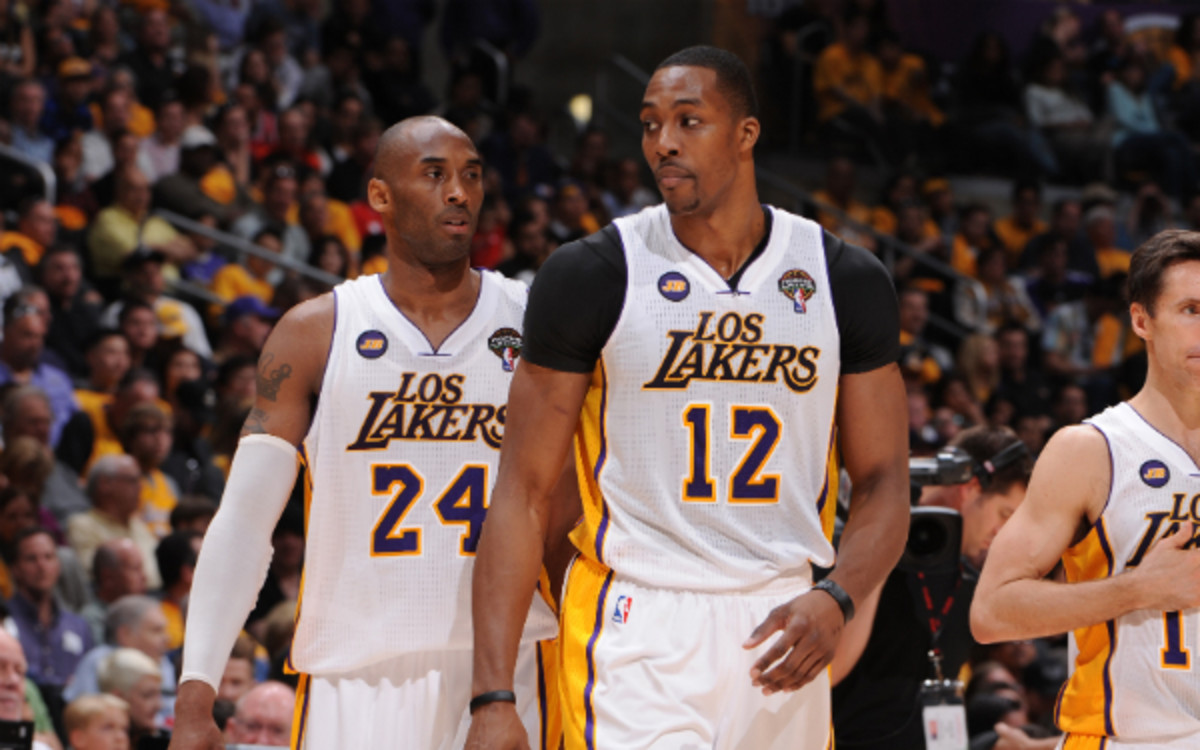 Kobe Bryant says it's imperative that the Lakers re-sign Dwight Howard. (Andrew D. Bernstein/Getty Images)