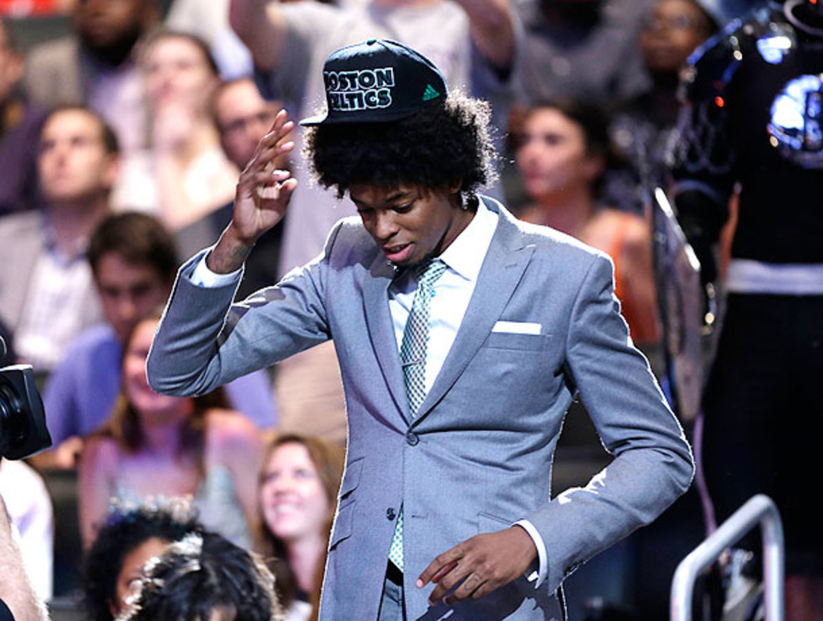 Lucas Nogueira's hair won its battle with his Celtics cap in emphatic fashion.