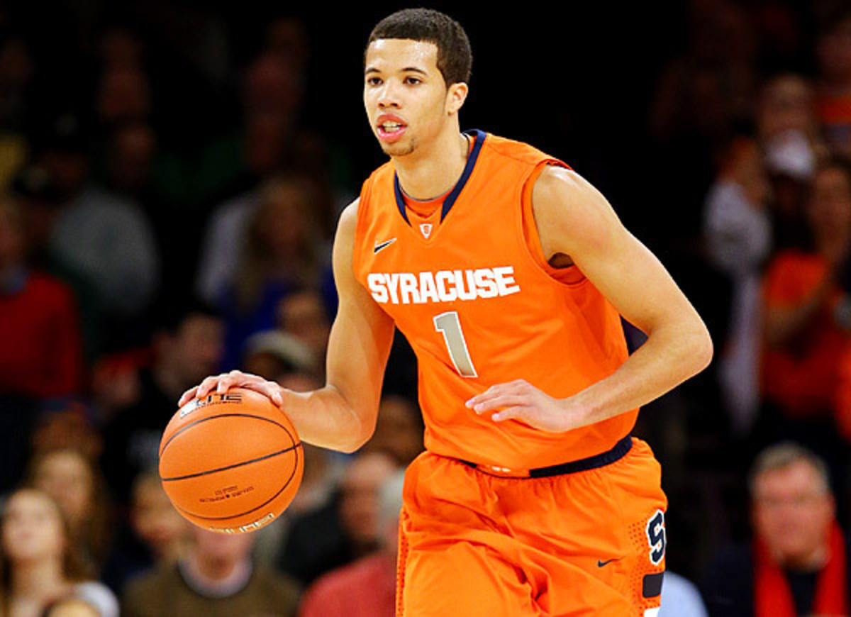 Michael Carter-Williams could become an all-around offensive force if he develops his jump shot. (Al Bello/Getty Images)