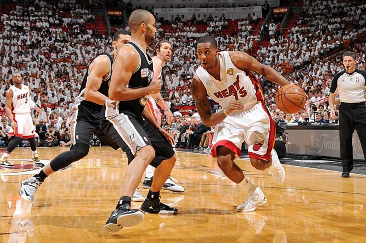 Point guard Mario Chalmers (right) has helped the Heat win back-to-back championships.