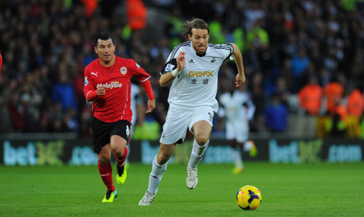 Swansea City forward Michu, right, will be out for about six weeks, as he requires surgery on his right ankle.