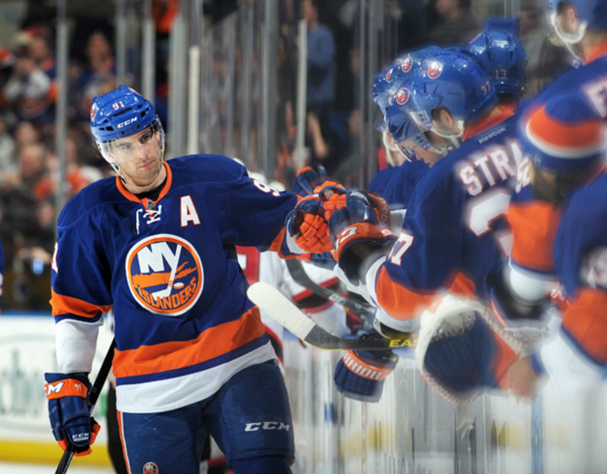 John Tavares scored a hat trick, as the Islanders defeated the Devils 5-1. (Christopher Pasatieri/ Getty Images)