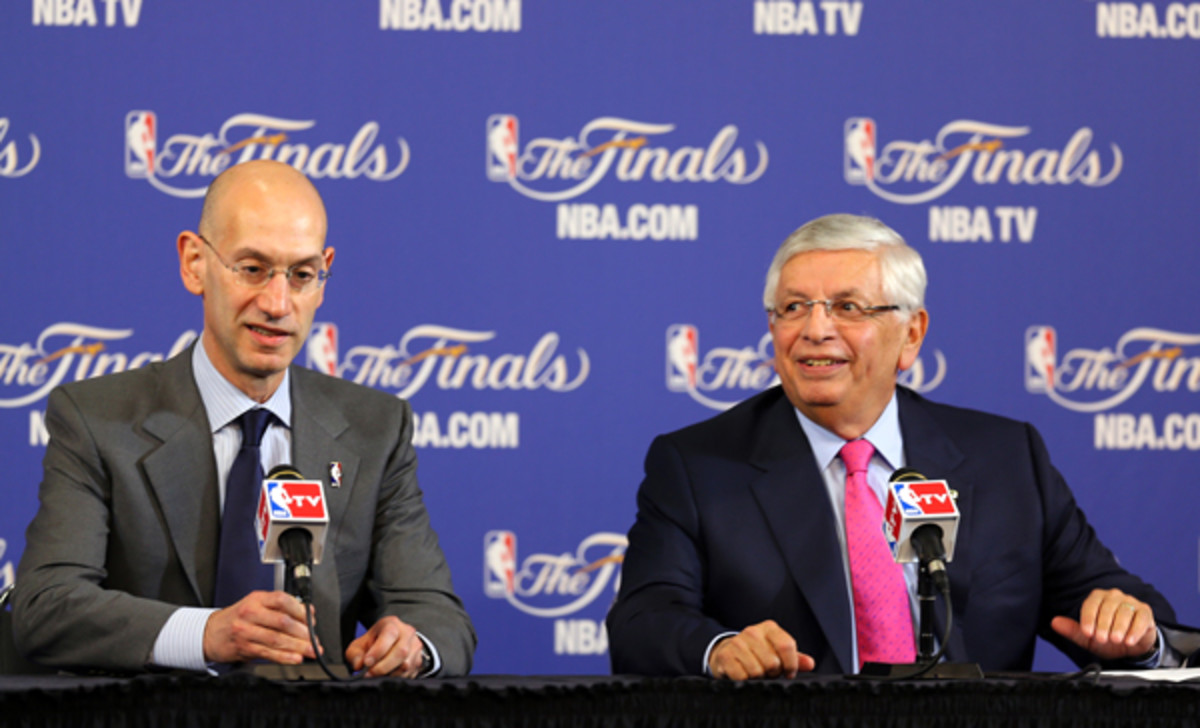 Adam Silver (left) will take over for David Stern (right) as NBA commissioner during the 2013-14 season. (Mike Ehrmann/Getty Images)