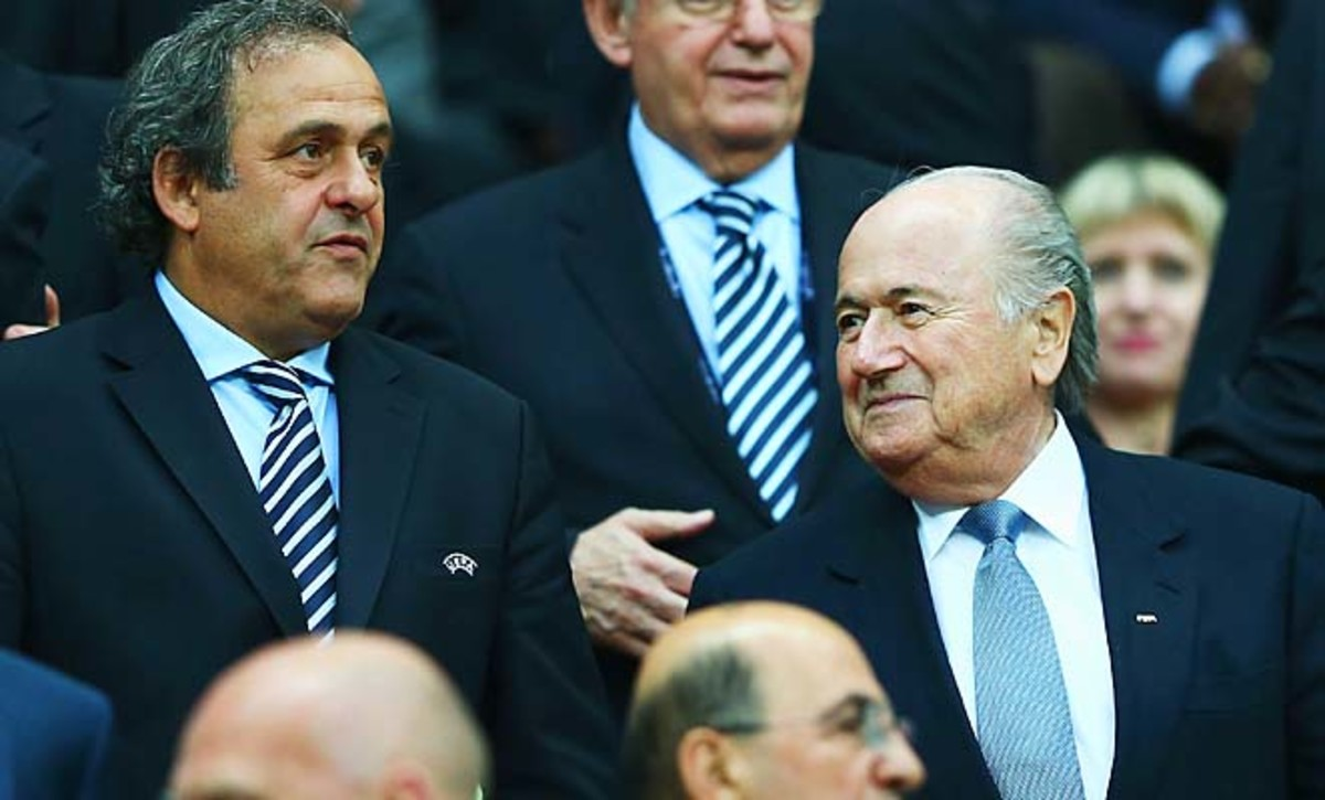 Michel Platini (left) and Sepp Blatter sit near each other at the Euro 2012 semifinals.