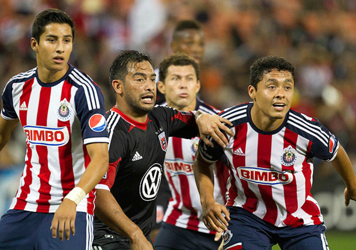 Carlos Ruiz (center) gave D.C. United a second-half lead when he scored against Chivas.