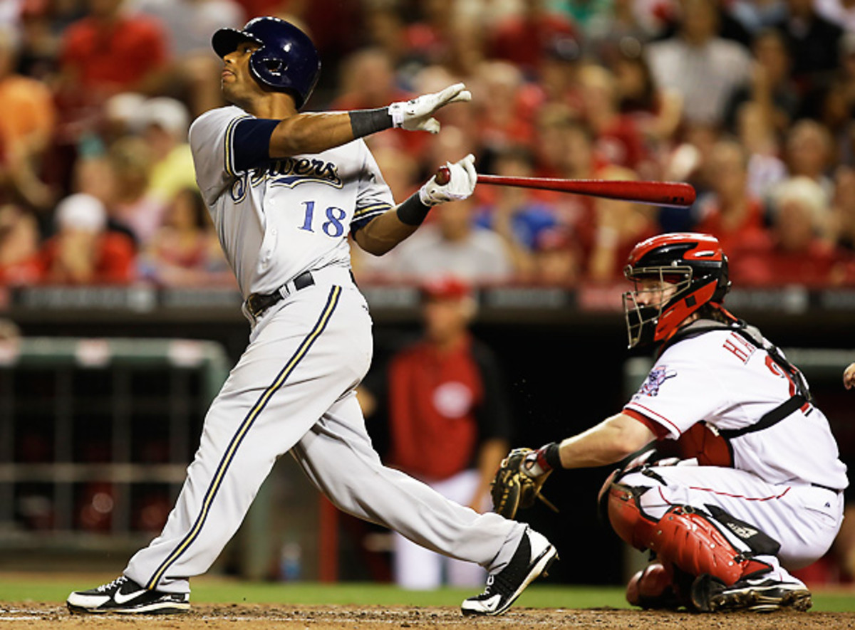 Khris Davis homered twice, including a go-ahead shot to lift the Brewers over the Reds. [Al Behrman/AP]