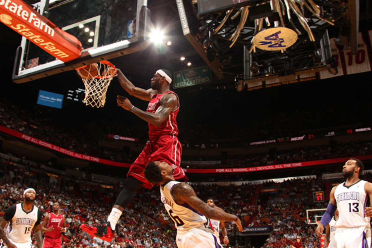A baseline view of LeBron James dunking over Ben McLemore. (Issac Baldizon/Getty Images)