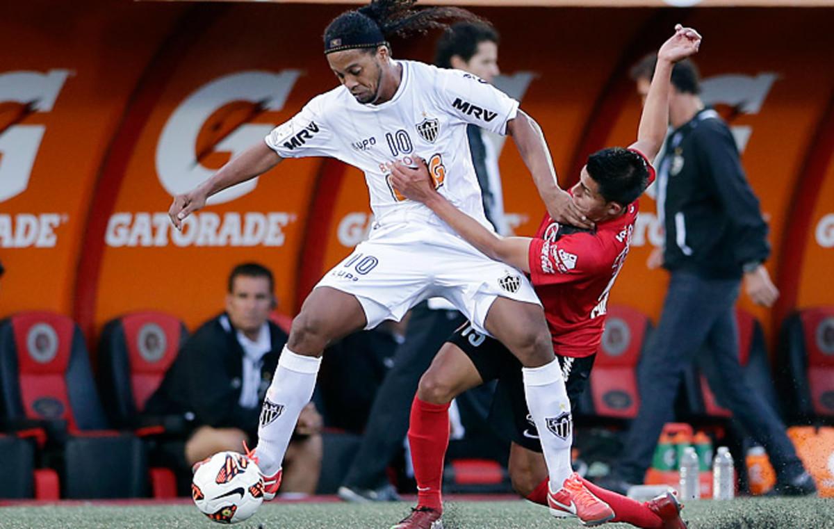 American Joe Corona (right), came on as a substitute in Tijuana's 2-2 draw with Ronaldinho's Atletico Mineiro.