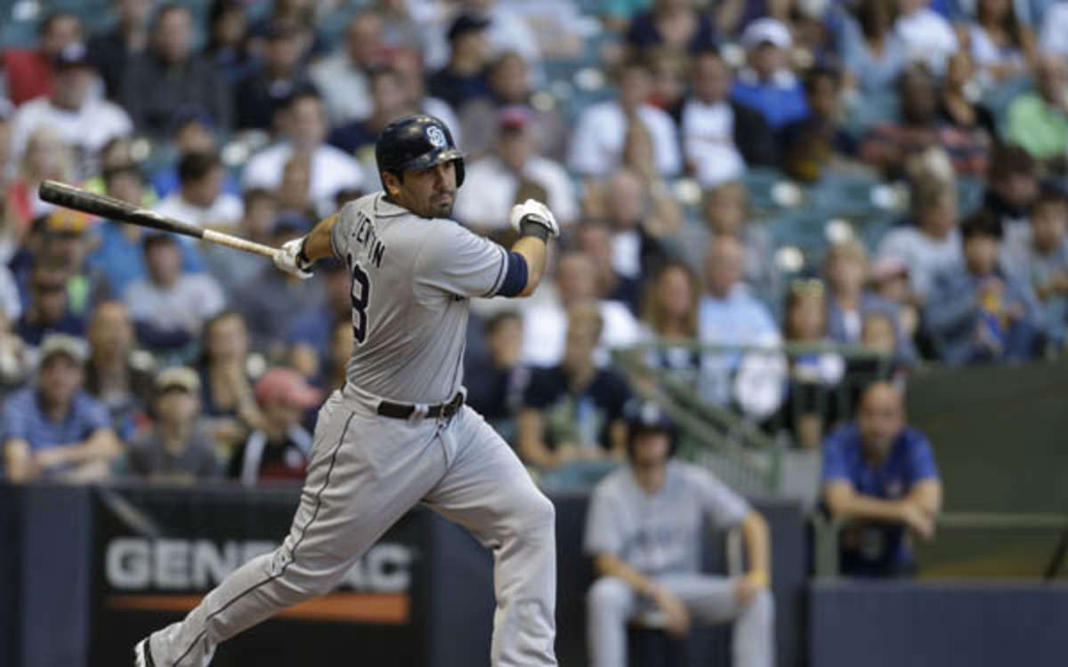 Padres outfielder Carlos Quentin will miss the rest of the year with a right knee injury. (Mike McGinnis/Getty Images)