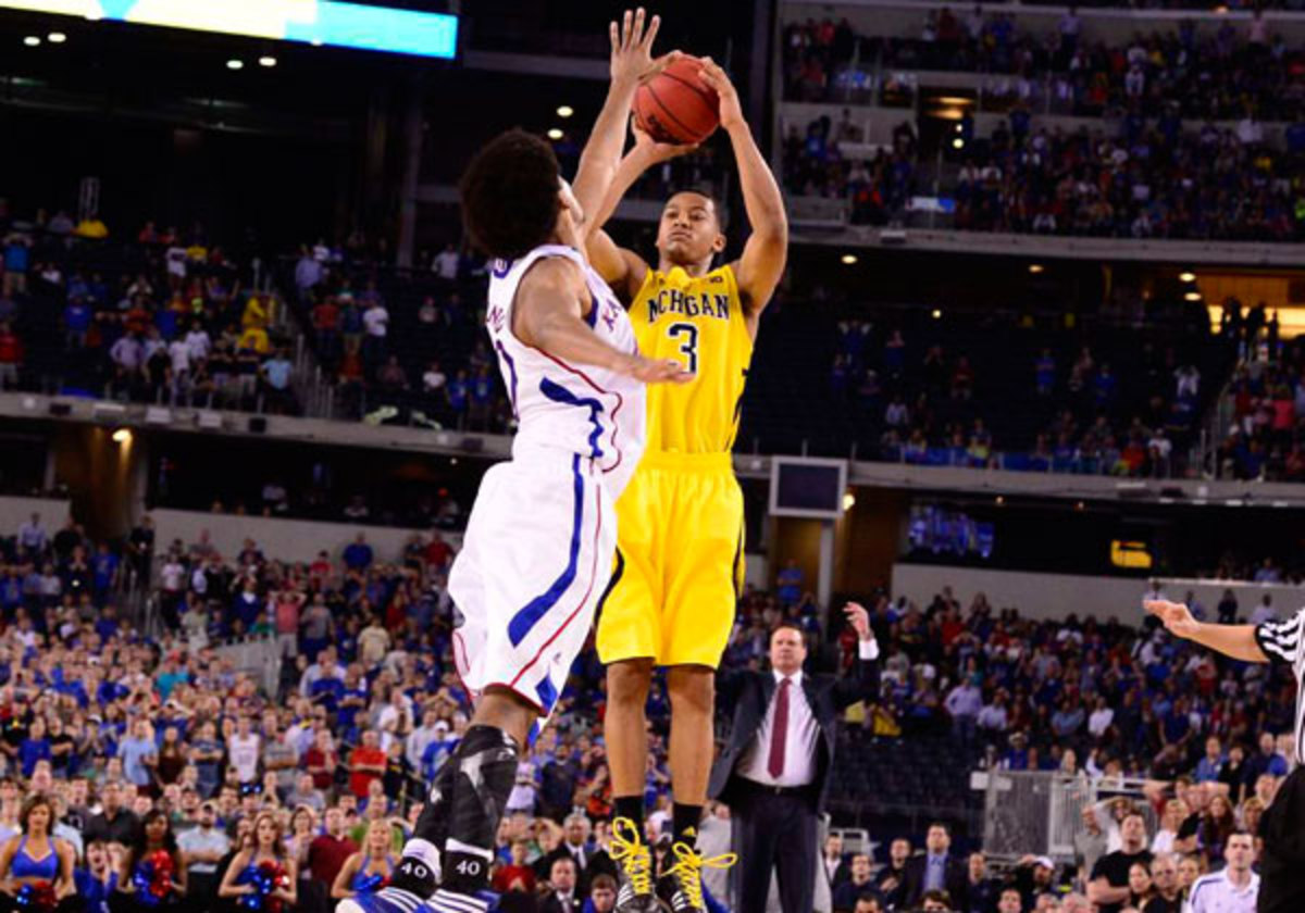 Trey Burke's clutch three from way beyond the three-point line sent the game to overtime, before Michigan pulled out the win. (Greg Nelson/SI)
