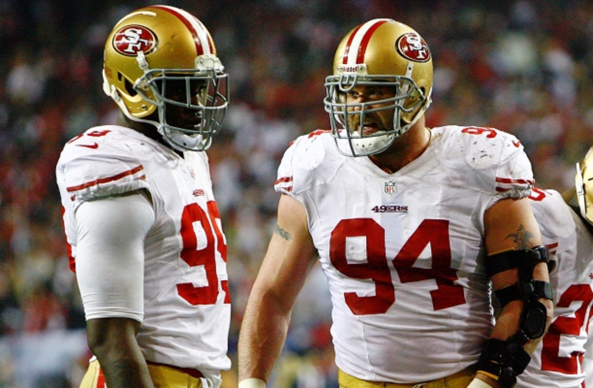 Justin Smith (94) and Aldon Smith form one of the league's most feared duos. (Kevin Terrell, AP)