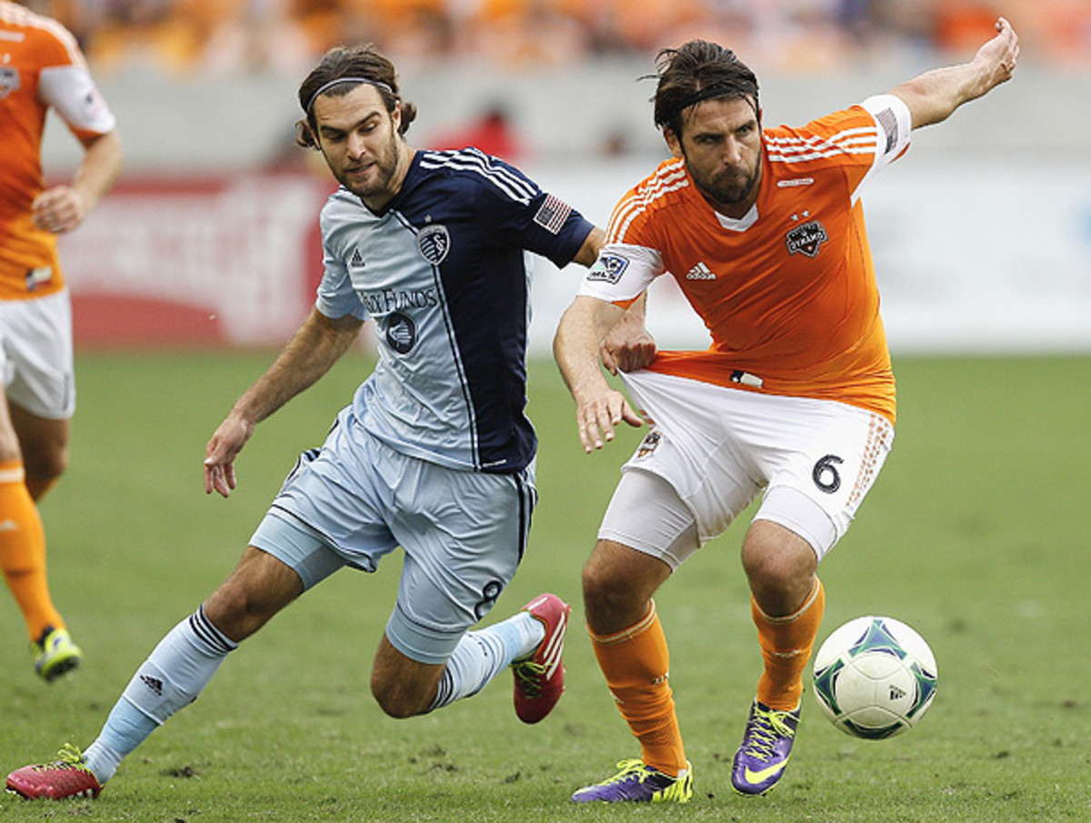 Graham Zusi (left) and Sporting Kansas City have fallen to Houston in the playoffs the last two seasons. (Bob Levey/AP)