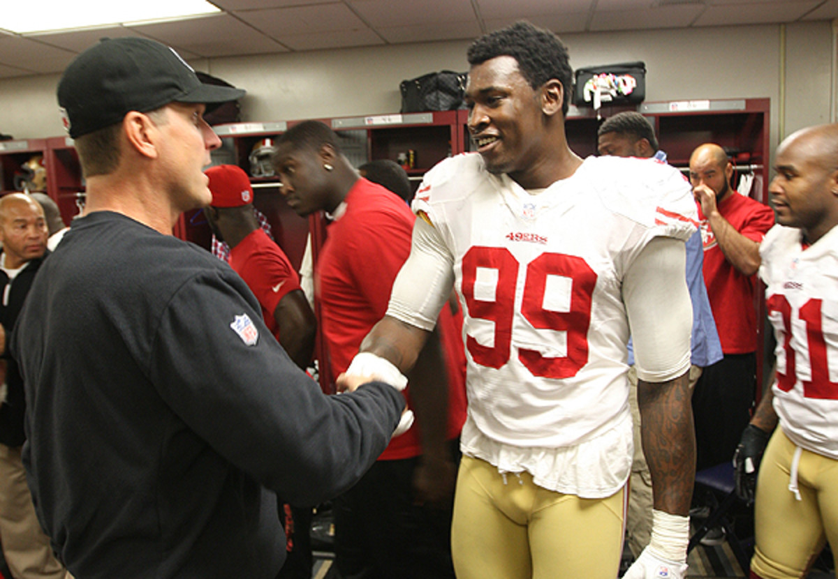 Jim Harbaugh is facing questions about his handling of OLB/DE Aldon Smith. (Michael Zagaris/Getty Images)