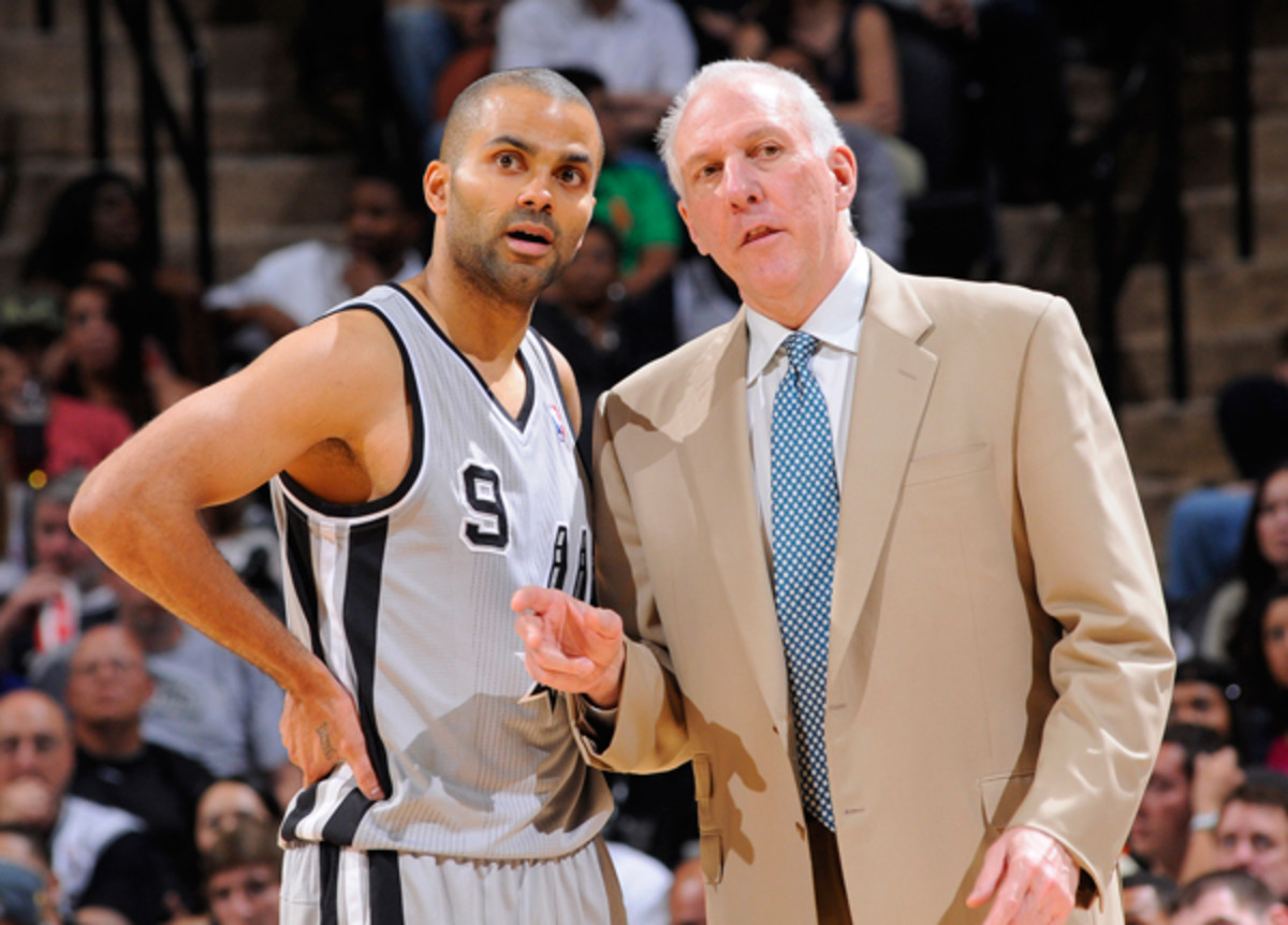 Spurs coach Gregg Popovich, right, is the subject of a Sports Illustrated story this week. (D. Clarke Evans/Getty Images)