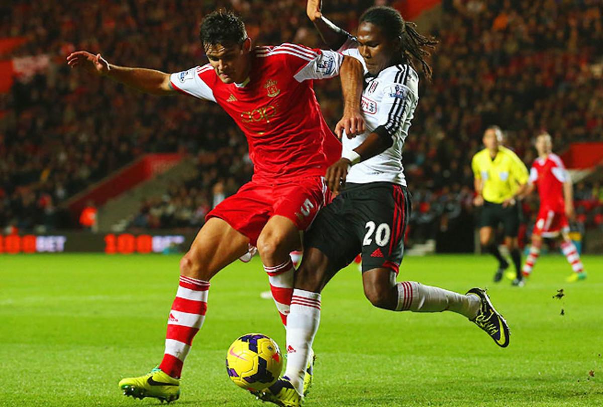 Dejan Lovren (left) of Southampton and Hugo Rodallega of Fulham battle for the ball.