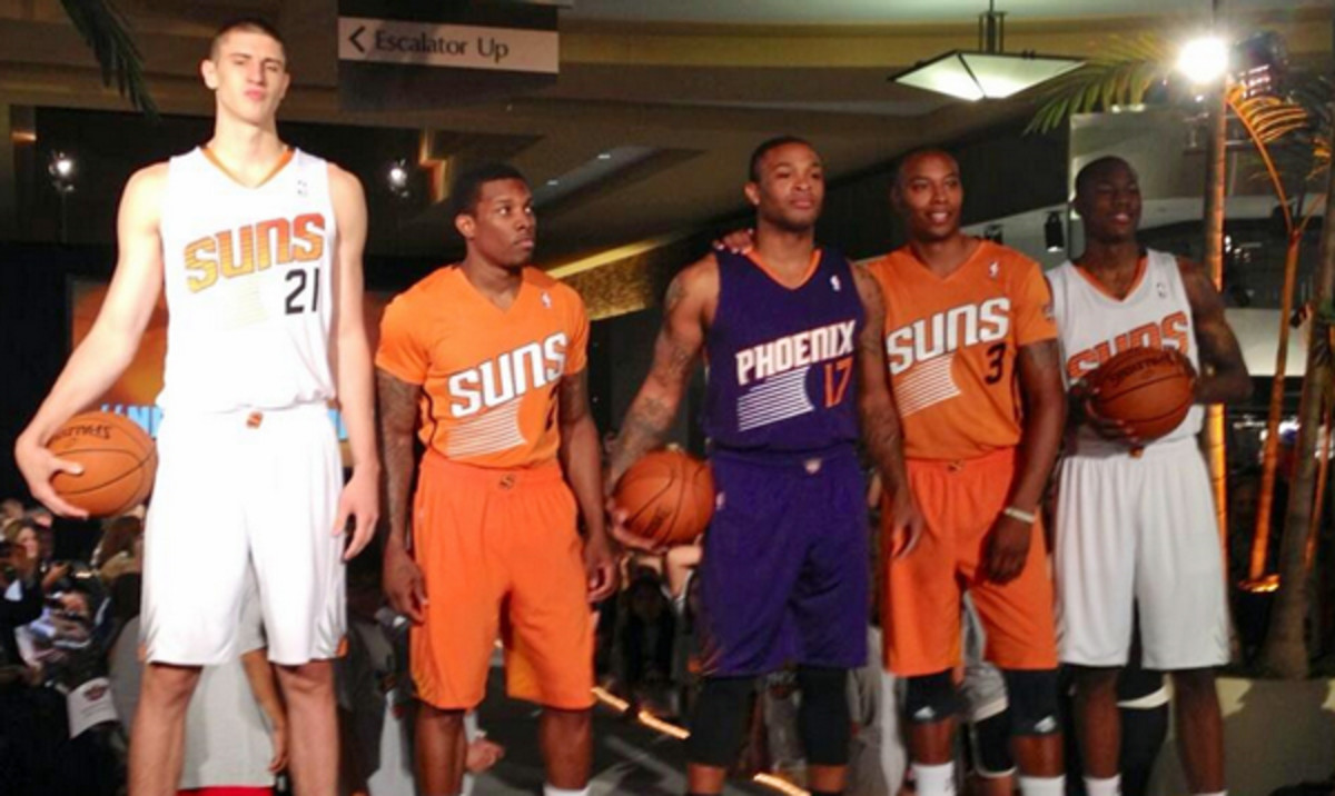 Members of the Suns model their new jerseys for the 2013-14 season. (@PaulCoro)
