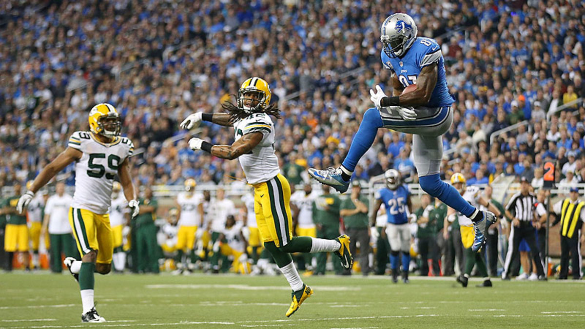 In last season's two games against the Packers, Calvin Johnson had 15 catches for 264 yards and one touchdown ... but the Lions lost both. (Leon Halip/Getty Images)