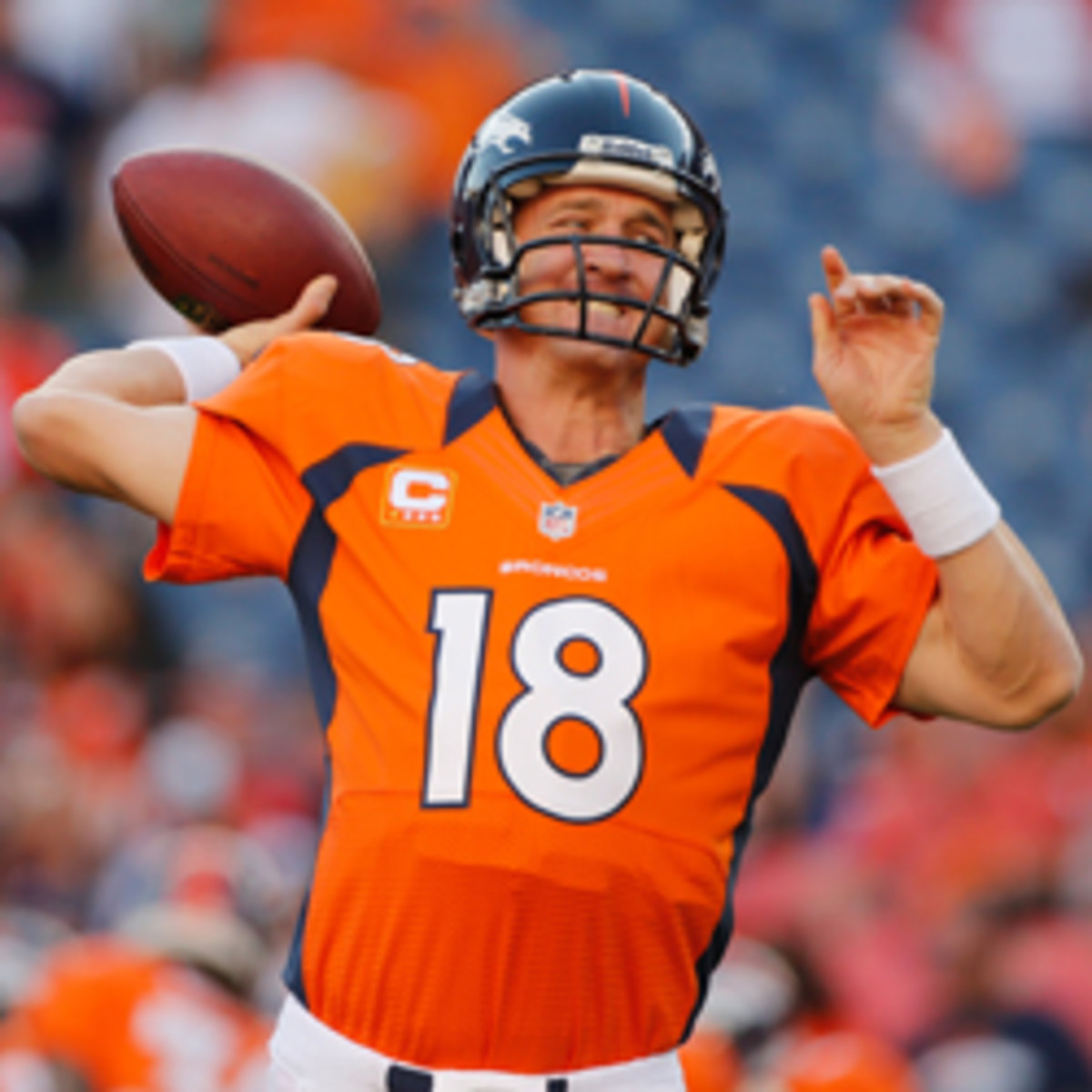 Broncos quarterback Peyton Manning is working out with three of his receivers at Duke University.  (Doug Pensinger/Getty Images)