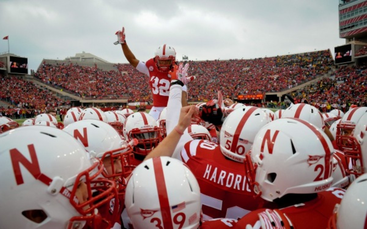 Nebraska kicks off two players following a bottle-throwing incident. (Photo by Eric Francis/Getty Images)