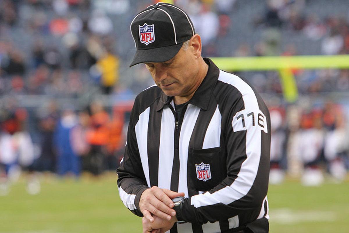 Side judge Mike Weatherford checks his watch pregame. (John DePetro/The MMQB)