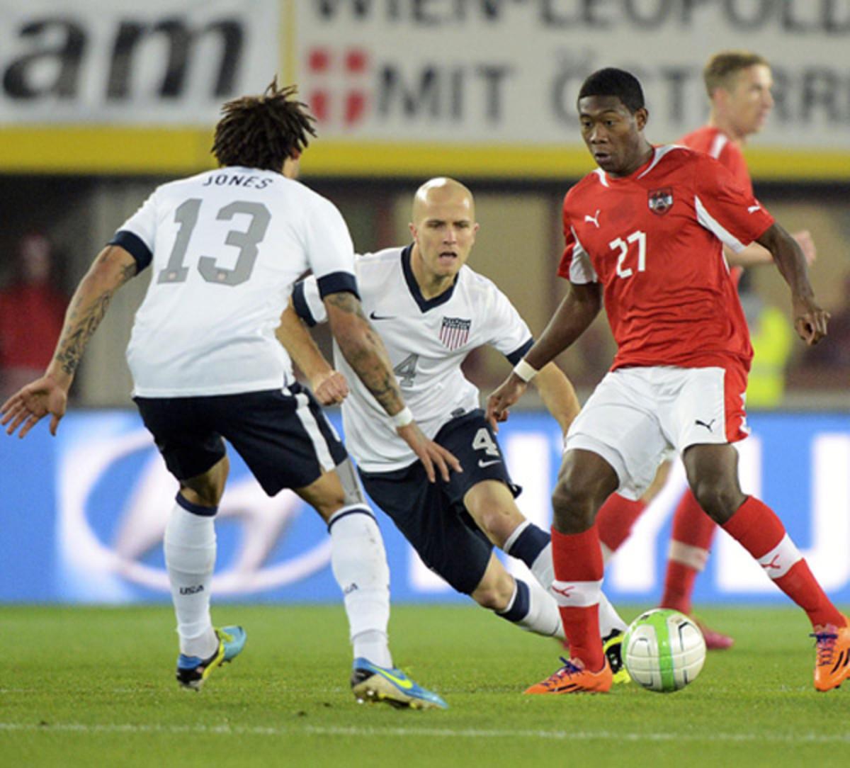 Jermaine Jones and Michael Bradley defend Austria and Bayern Munich's David Alaba. (Helmut Fohringer/EPA)