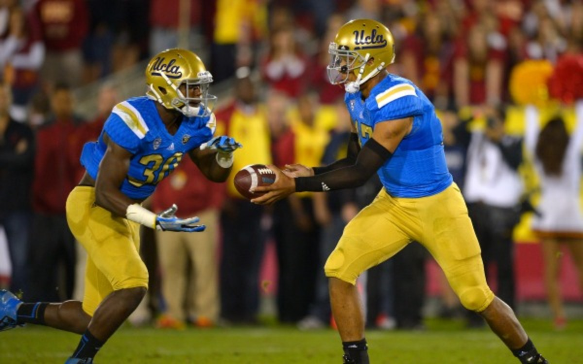Two-way freshman star Myles Jack scored seven touchdowns in limited offensive snaps. (AP Photo/Mark J. Terrill)