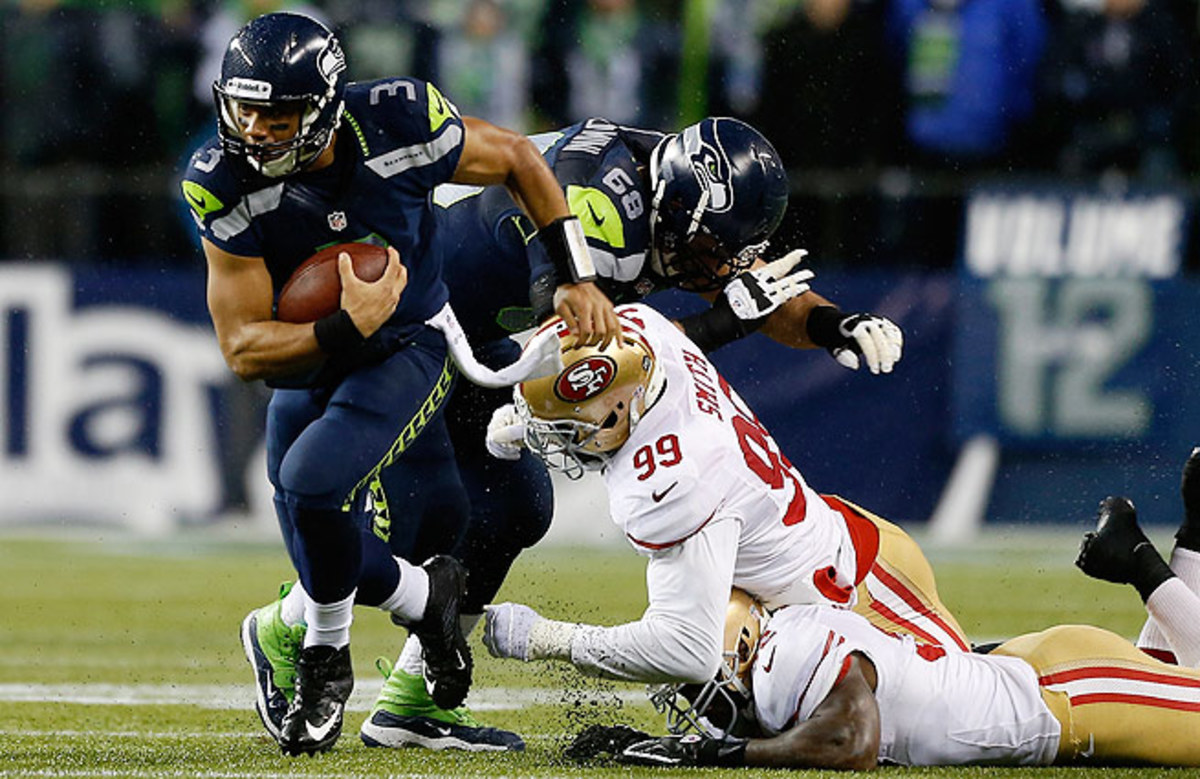 Russell Wilson (left) and the Seahawks destroyed the 49ers 42-13 in their last meeting.