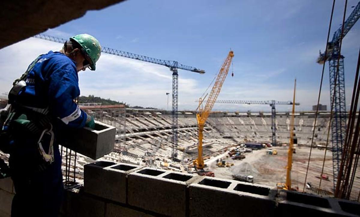 A construction worker lays blocks at the Maracana soccer stadium in November.