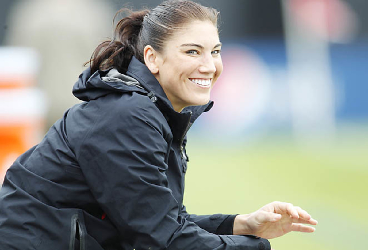 Hope Solo watches the U.S. play a friendly against Scotland earlier this month.