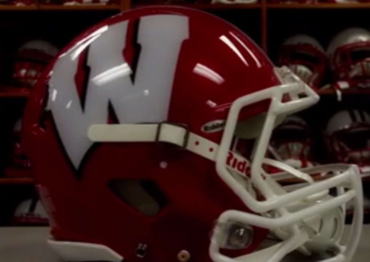 Wisconsin's red helmets are an inversion of its typical white helmet with a red logo.
