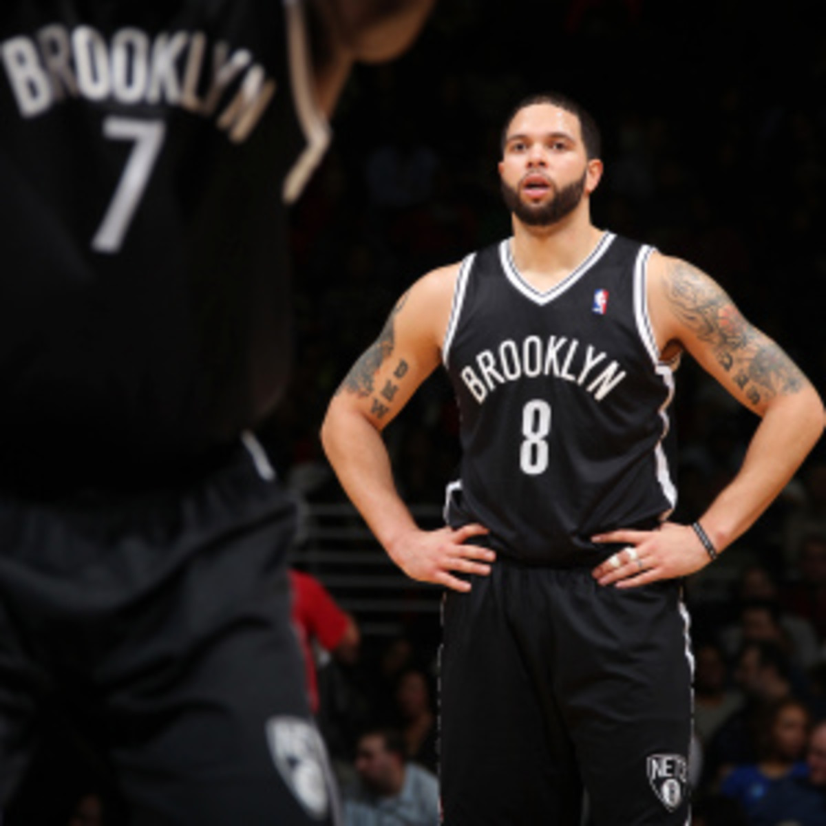 Deron Williams will play Tuesday night but said he's not 100 percent and can't jump without pain. (Ned Dishman/Getty Images)