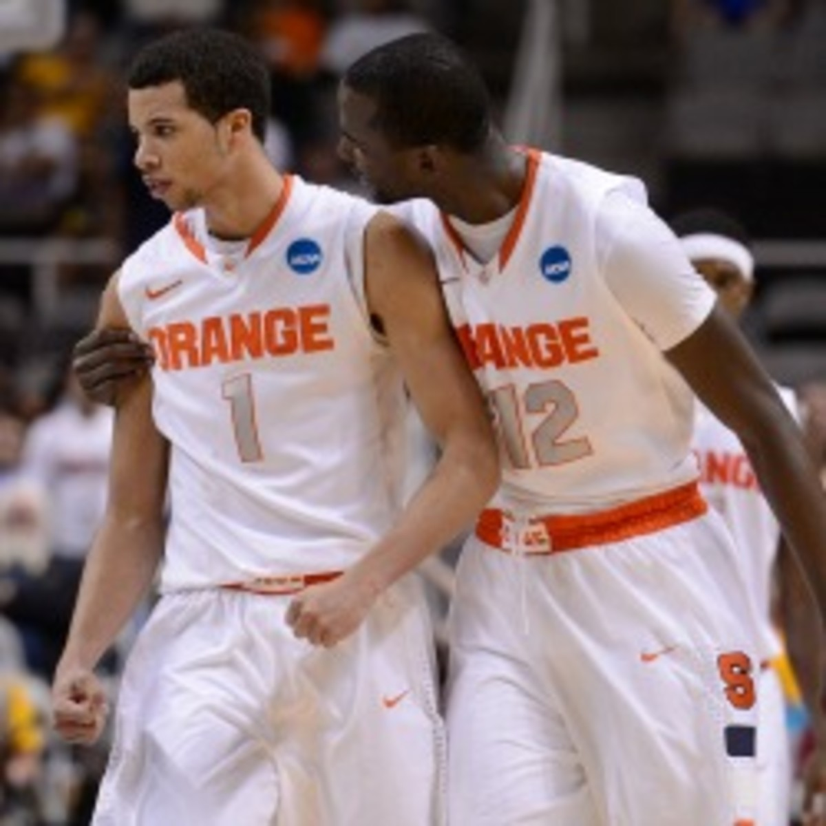 Syracuse sophomore Michael Carter Williams (left) said his family was OK after his house caught on fire during Saturday night's game. (Thearon W. Henderson/Getty Images)