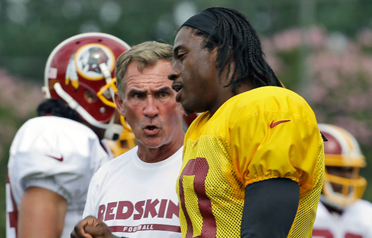 Robert Griffin III made an unexpected media appearance Tuesday to say he was not in conflict with coach Mike Shanahan over the quarterback's return to the field.