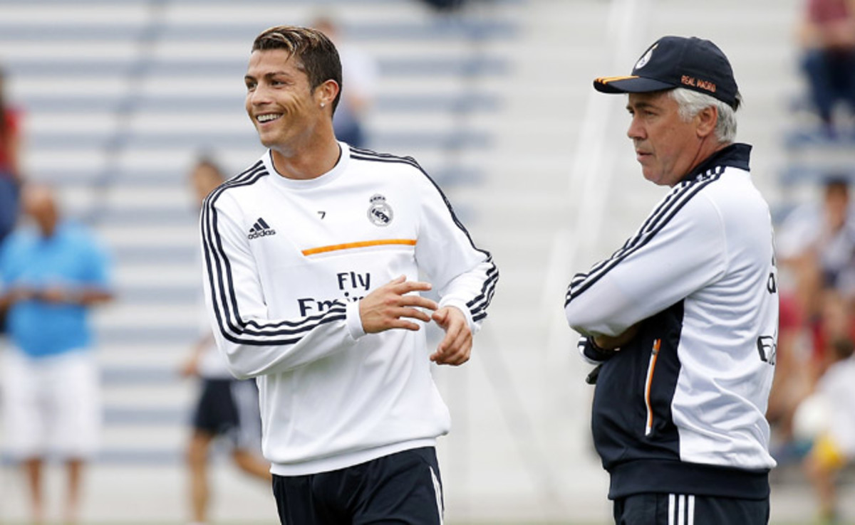 Real Madrid's Carlo Ancelotti (right) will face his former club, Juventus, in Group B.