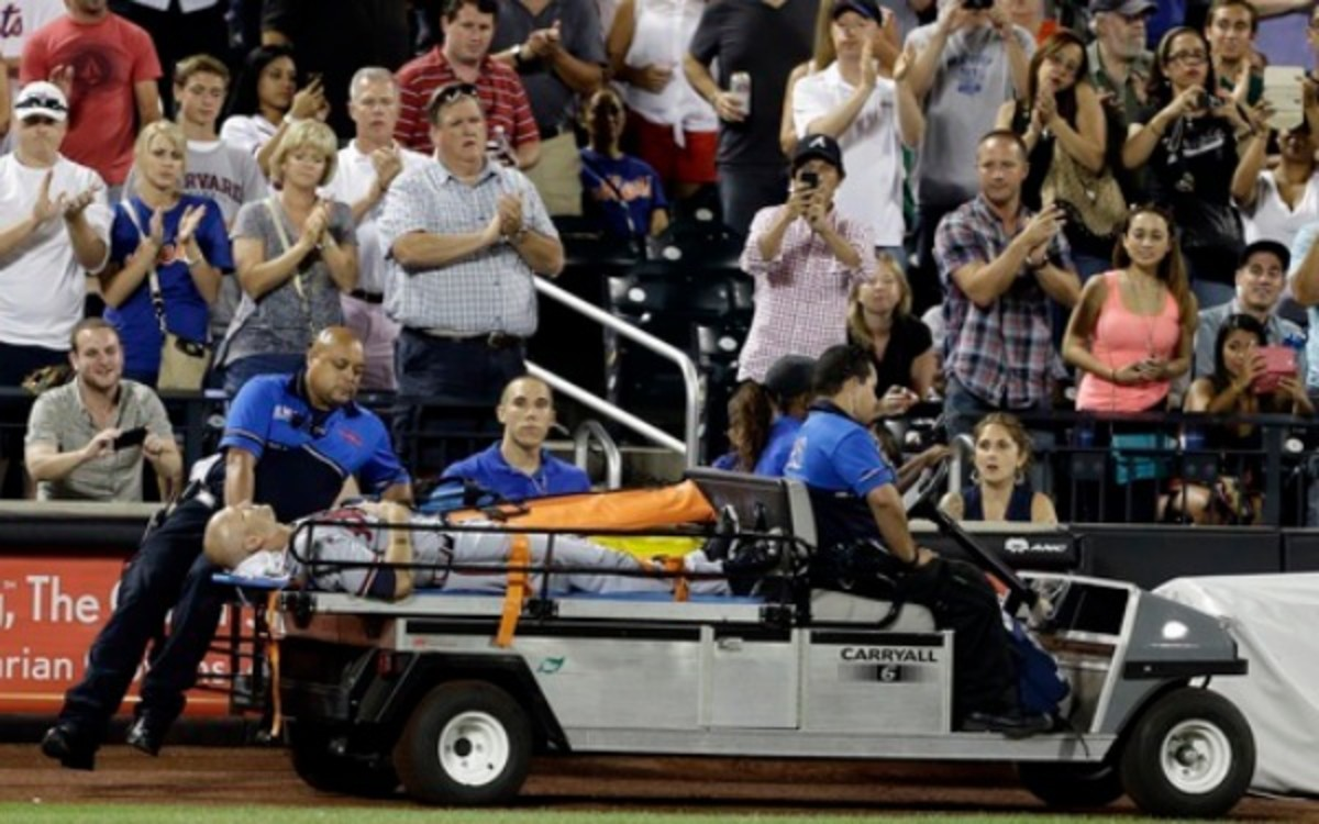 Atlanta Braves' Tim Hudson is carted off the field after a leg injury. (AP Photo/Frank Franklin II)