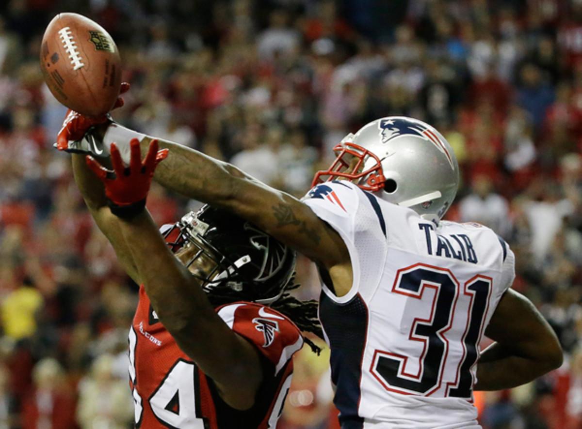 Patriots cornerback Aqib Talib denies Atlanta's Roddy White at the end of the game. (David Goldman/AP)