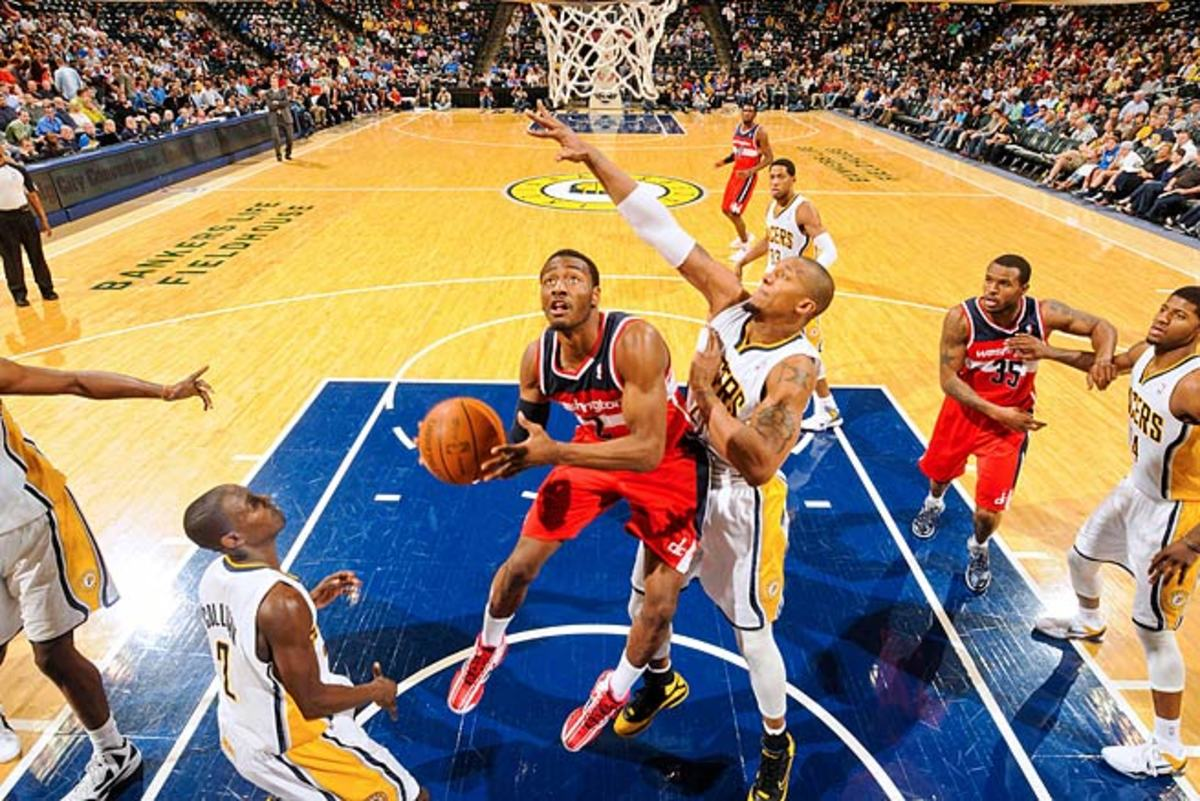 John Wall is averaging 16.9 points, 8.0 assists and 4.4 rebounds in his three-year career.