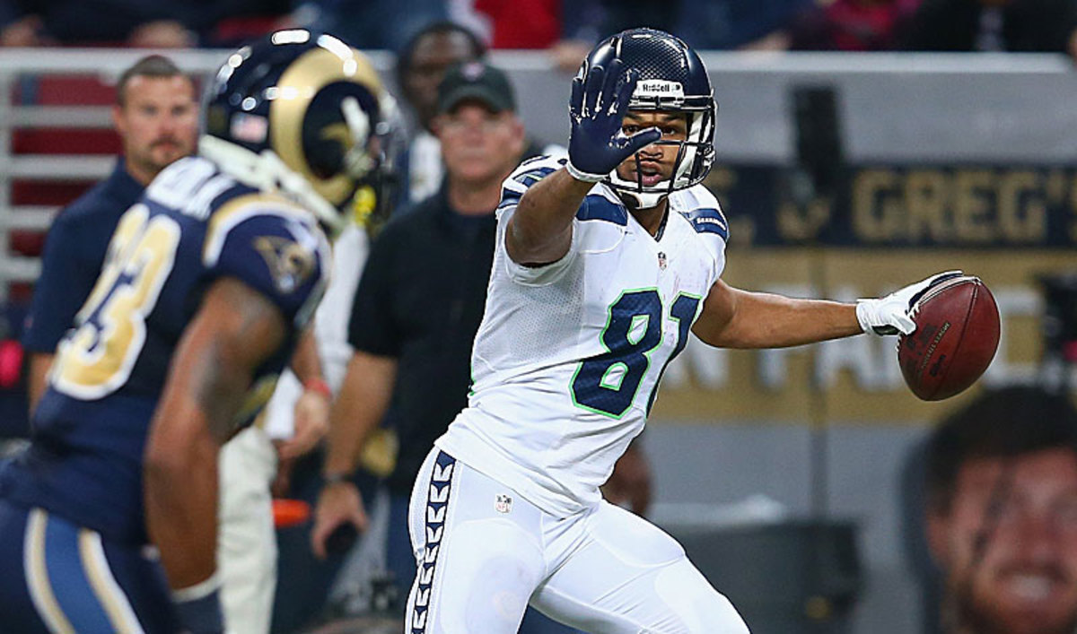 Golden Tate admitted it was 'immature' to wave at the Rams' defense while running in a touchdown. His act led to a penalty. (Andy Lyons/Getty Images)