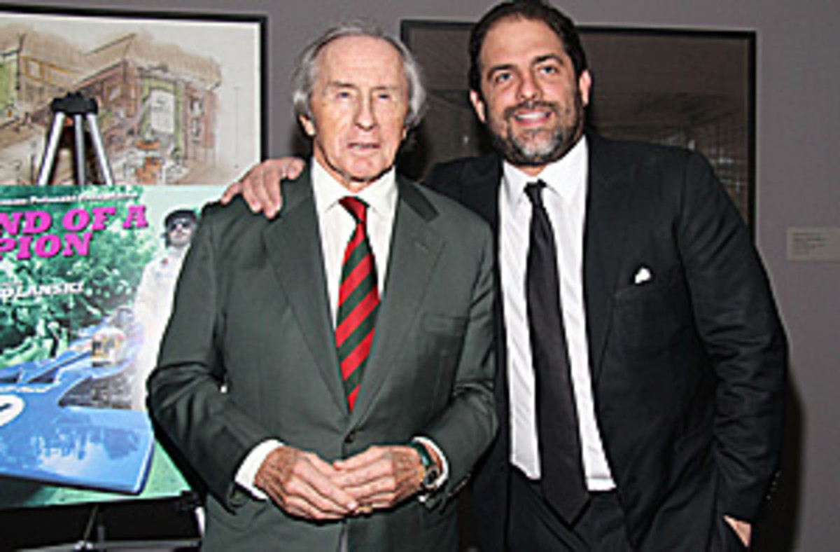 The ever dashing Sir Jackie with Brett Ratner at the U.S. premiere of Weekend of a Champion.