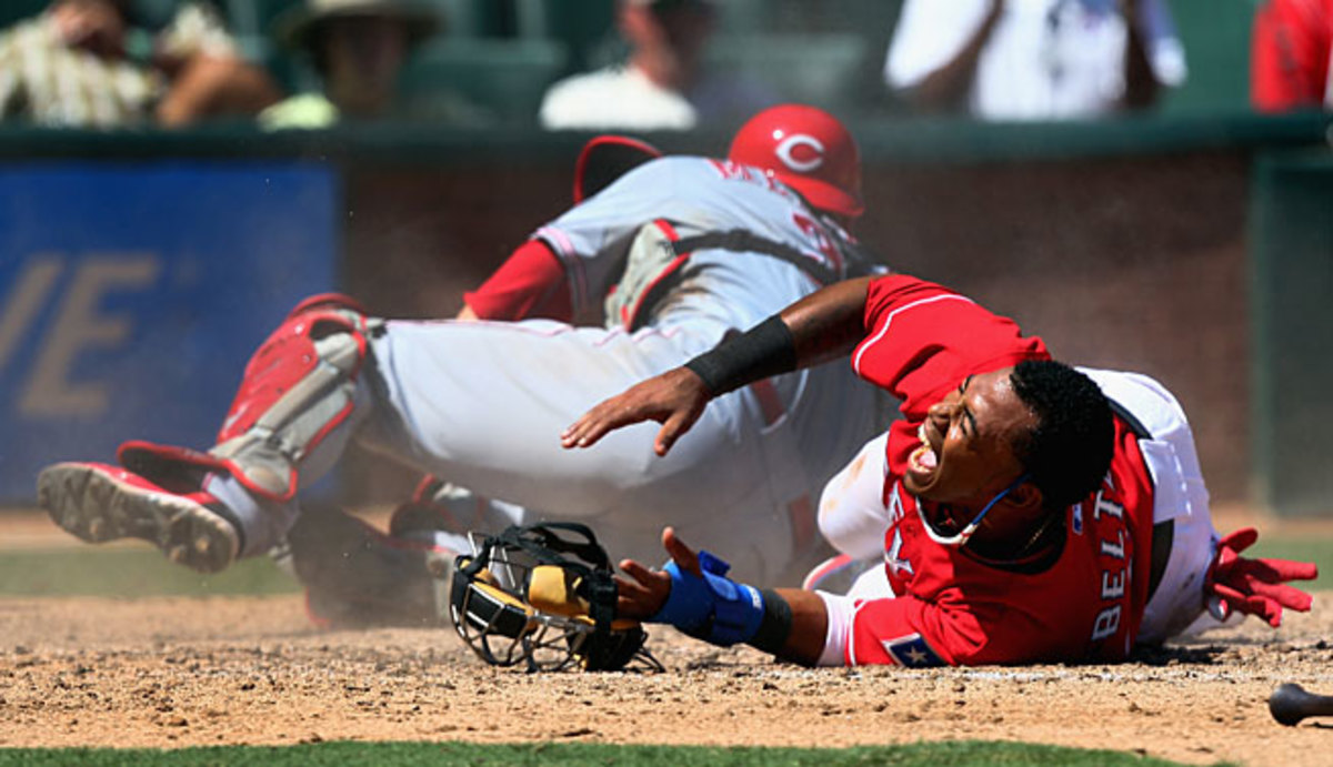 Engel Beltre (right) and Devin Mesoraco were just two of the players who in 2013 demonstrated how painful home plate collisions can be.