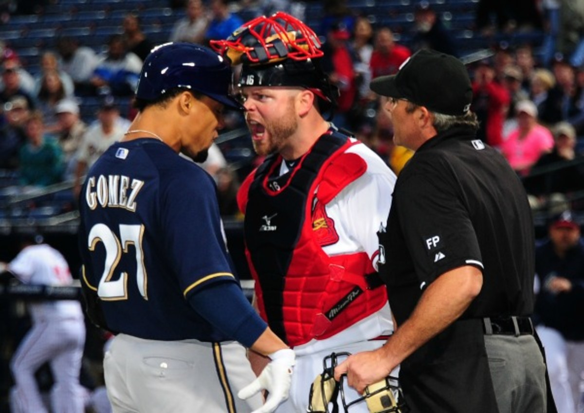 Brian McCann gets in Carlos Gomez's face after a home run. (Scott Cunningham/Getty Images)