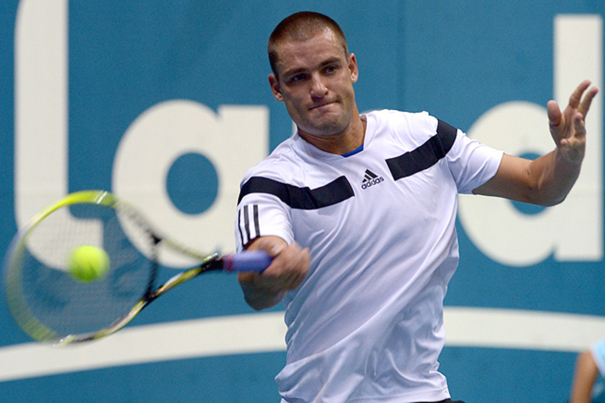 After being sick the night before, Mikhail Youzhny recovered to beat Paolo Lorenzi 6-3, 6-2.