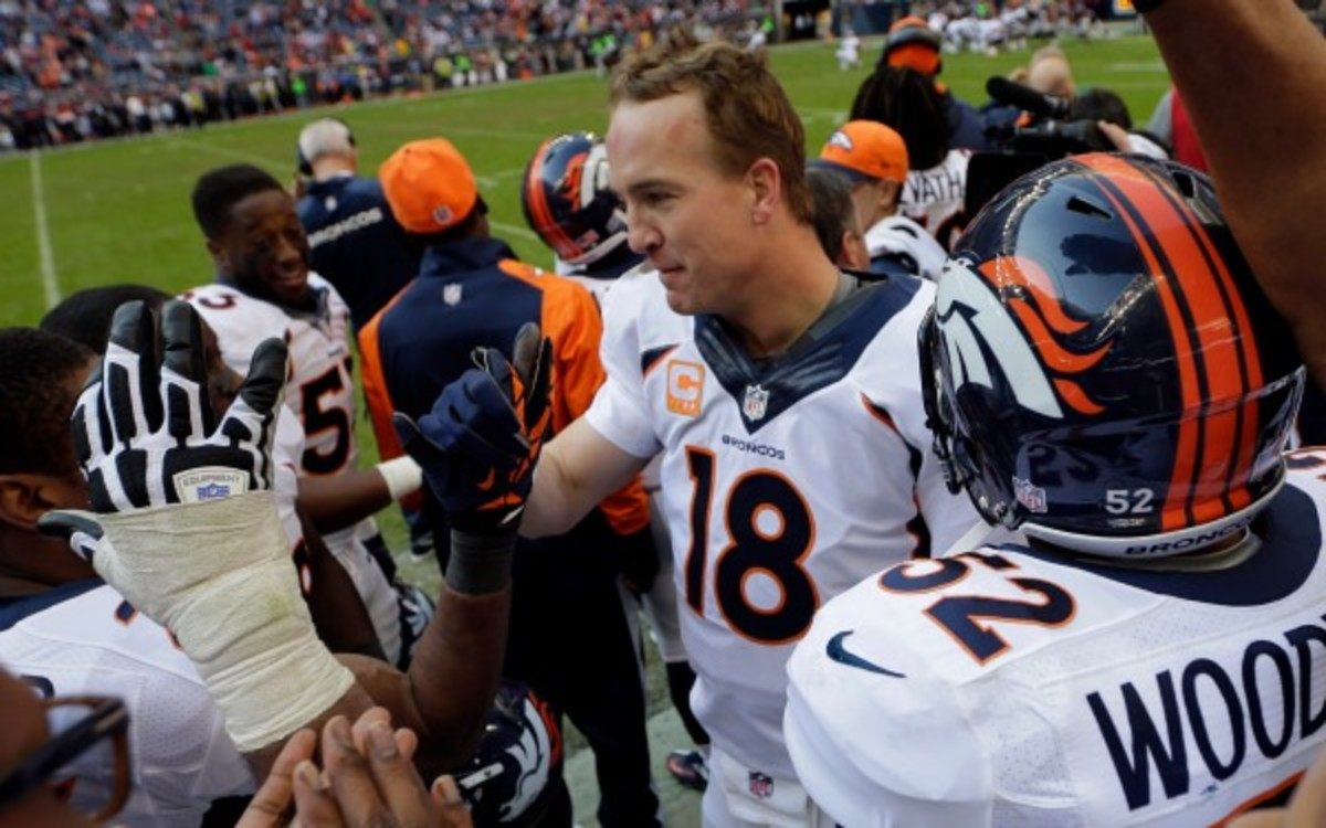 Peyton Manning is congratulated by teammates after his 51st passing touchdown. (AP Photo/David J. Phillip)