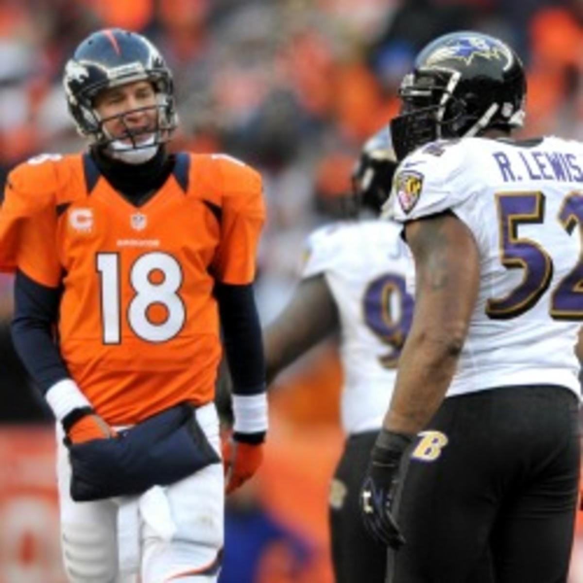 Broncos quarterback Peyton Manning threw 37 regular-season touchdown passes, but his overtime interception led to a second-round playoff exit. (Dustin Bradford/Getty Images)