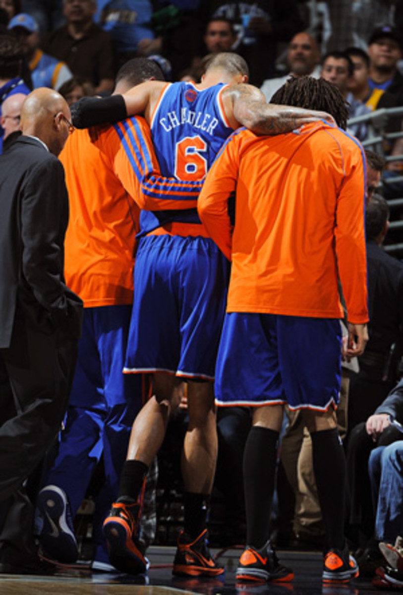 Tyson Chandler has dealt with injuries to his knee and neck this week. (Garrett Ellwood/Getty Images)