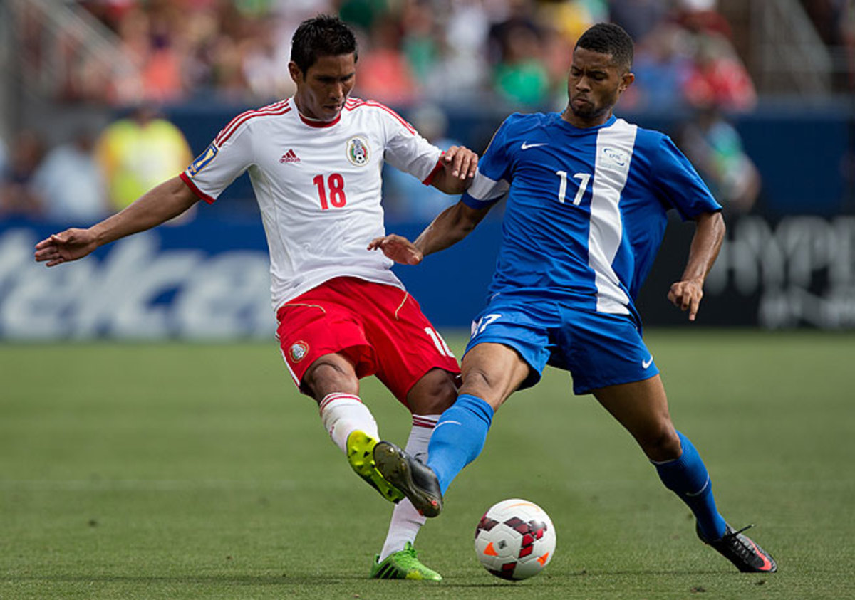 Isaac Brizuela (right) and Martinique scored first but could not hold off Juan Carlos Valenzuela and Mexico.