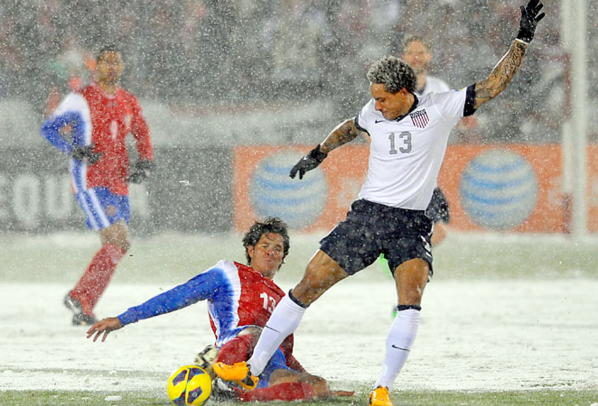 U.S. midfielder Jermaine Jones is tackled by Costa Rica's Angel Rodriguez during their World Cup qualifying match.